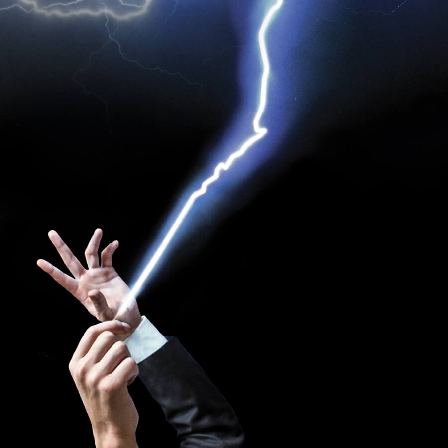 Orchestra conductor hands with baton shooting lightning into the night sky.